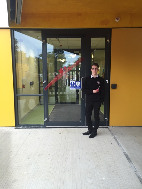 conor martin cutting the ribbon on the students 1st day in new building
