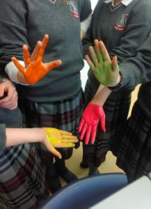 The students painted their hands to show how easily germs can be spread when there is a lack of clean water